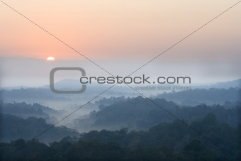 sun rise above a fog and mountain