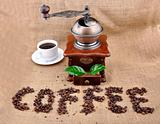 vintage coffee grinder and sign coffe from coffee granules