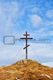 cross against the sky on high hill
