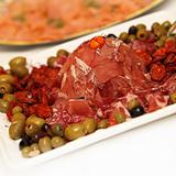 Ham and salami decorated with olives