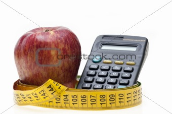 Apple, tape and calculator