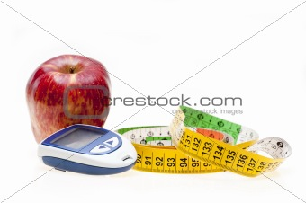 Apple, tape and glucometer