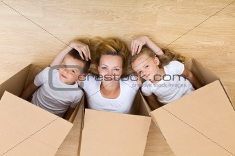 Happy family unpacking