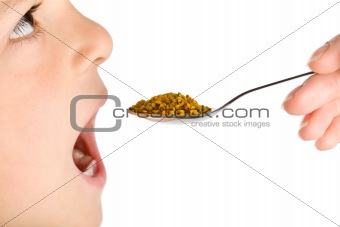 Boy taking traditional medicine - pollen granules