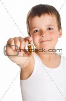Little boy holding bottle with pollen - isolated