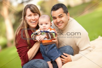 Happy Mixed Race Family Posing for A Portrait in the Park.
