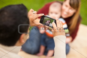 Happy Mixed Race Parents and Baby Boy Taking Self Portraits at the Park.