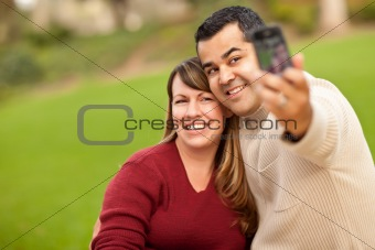 Attractive Mixed Race Couple Taking Self Portraits in the Park.