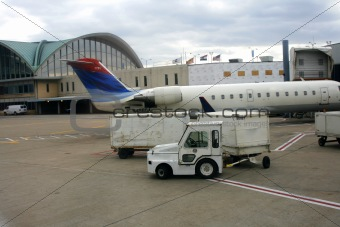 Close up on a Plane and cargo car