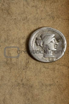 Ancient silver denauius coin on paper