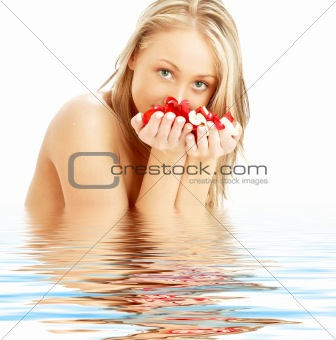 blond with red and white rose petals in water
