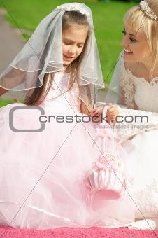 happy bride and little bridesmaid