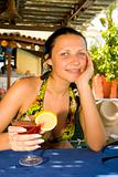 Young beautiful smiling woman drinking cocktail