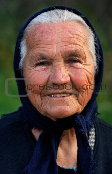 A senior Greek lady with a warm smile