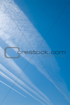 airplane's tracks in clear blue sky