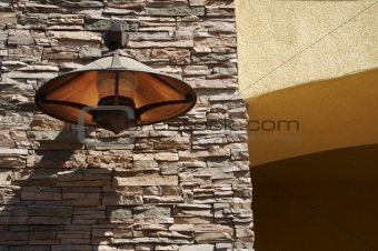 Abstract Slate Rock & Stucco Wall with Copper Lamp