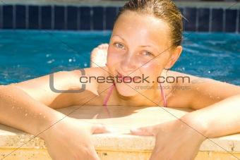 beautiful girl relaxing at the pool