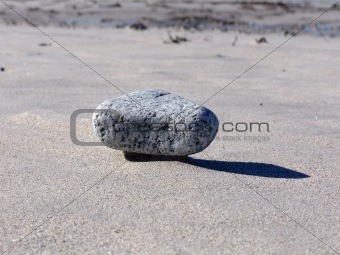 Floating rock on sand