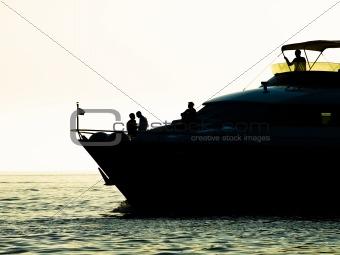 Motor boat in sunset