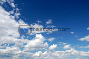 a blue sky with many white clouds