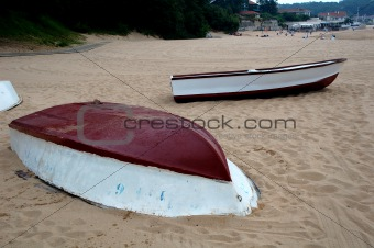 a boat lying on a beach in spain