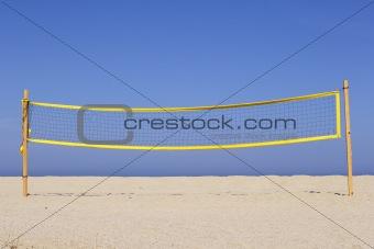 beach volleyball net on sandy beach, corsica