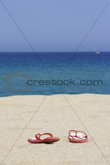 flip flops on empty sandy beach, corsica