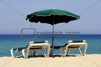 sun lounger on sandy beach, corsica, mediterranean