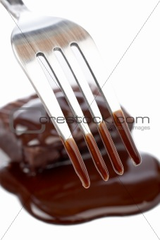 Fork and two chocolate cakes