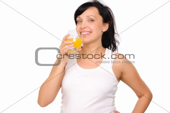 Young pregnant woman drinking orange juice