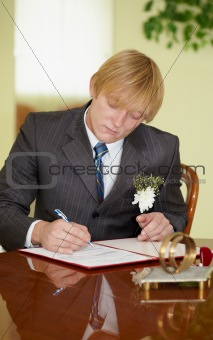 Groom solemnly signed documents