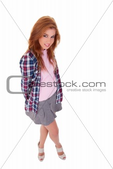 young woman with a schoolgirl outfit, isolated on white, studio shot