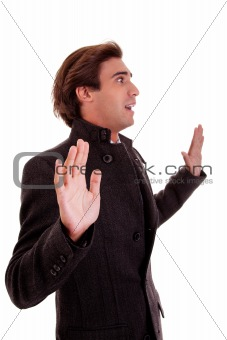 An admired businessman, with open arms as a signal to stop, isolated on white background.