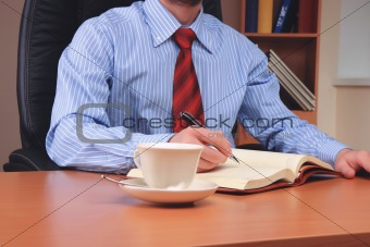 Businessman at office working at his workplace.