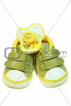 Baby's bootee and pacifier