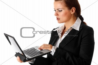 thoughtful modern business woman  looks in laptops screen