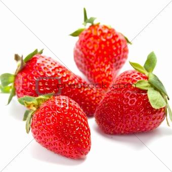 four fresh strawberries
