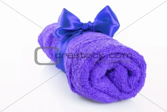 Twisted blue towel with band isolated on white