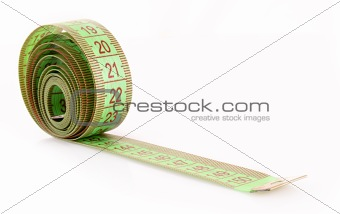 Green measure tape isolated on white