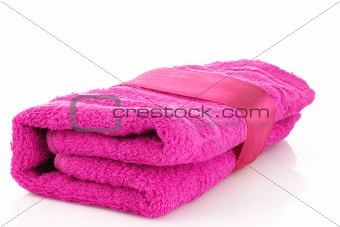 Folded pink towel with the band isolated on white