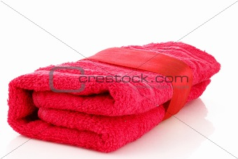 Folded red towel with the band isolated on white