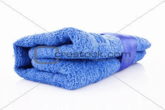 Folded blue towel with the band isolated on white