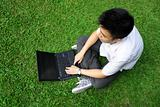 asian man using computer outdoor
