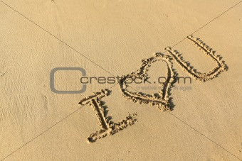 """""""I love you"""" drawing on the beach"""