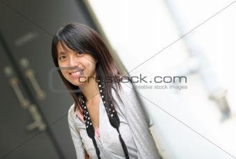 asian woman in casual wear in city