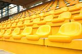 Yellow chairs inside the stadium