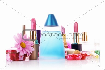 Lipstick and perfume isolated on white