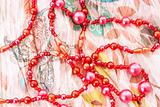red chaplet on textile background