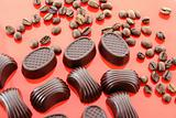 Chocolate and coffee beans on red background