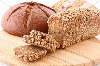 Bread on wooden plate isolated on white